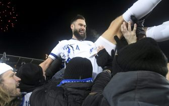 Finnish captain Tim Sparv celebrates with fans after the UEFA Euro 2020 Group J qualification football match between Finland and Liechtenstein in Helsinki, Finland, on November 15, 2019. - Finland has qualified for the first time for a major football tournament. (Photo by Markku Ulander / Lehtikuva / AFP) / Finland OUT (Photo by MARKKU ULANDER/Lehtikuva/AFP via Getty Images)