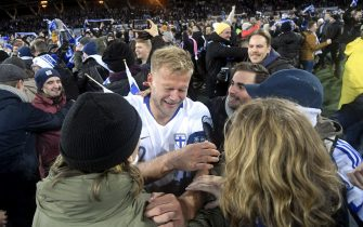 Paulus Arajuuri of Finland celebrates with fans after the UEFA Euro 2020 Group J qualification football match between Finland and Liechtenstein in Helsinki, Finland, on November 15, 2019. - Finland has qualified for the first time for a major football tournament. (Photo by Markku Ulander / Lehtikuva / AFP) / Finland OUT (Photo by MARKKU ULANDER/Lehtikuva/AFP via Getty Images)