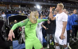 Goalkeeper Lukas Hradecky (L) of Finland wears a mask of an eagle owl as he celebrates with Paulus Arajuuri after the UEFA Euro 2020 Group J qualification football match between Finland and Liechtenstein in Helsinki, Finland, on November 15, 2019. - Finland has qualified for the first time for a major football tournament. (Photo by Markku Ulander / Lehtikuva / AFP) / Finland OUT (Photo by MARKKU ULANDER/Lehtikuva/AFP via Getty Images)