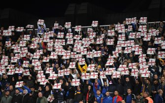 PRISTINA, KOSOVO - NOVEMBER 17: Fans hold up England flags during the UEFA Euro 2020 Qualifier between Kosovo and England at the Pristina City Stadium on November 17, 2019 in Pristina, Kosovo. (Photo by Michael Regan/Getty Images)