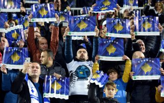 Fans hold up posters with the Kosovo flag before the UEFA Euro 2020 Group A football qualification match between Kosovo and England at the Fadil Vokrri stadium in Prishtina on November 17, 2019. (Photo by Robert ATANASOVSKI / AFP) (Photo by ROBERT ATANASOVSKI/AFP via Getty Images)