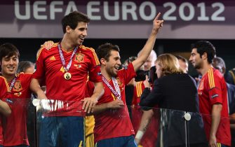 Spanish players Javi Martinez (L) and Jordi Alba celebrate after winning the Euro 2012 football championships final match Spain vs Italy on July 1, 2012 at the Olympic Stadium in Kiev. AFP PHOTO / GIUSEPPE CACACE        (Photo credit should read GIUSEPPE CACACE/AFP/GettyImages)