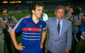 27 Jun 1984:  Michel Platini of France with coach Michel Hidalgo after victory in the European Championship Final against Spain at Parc des Princes in Paris. France won the match 2-0. \ Mandatory Credit: David Cannon /Allsport