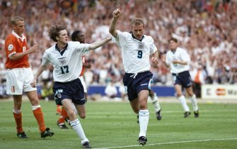 18 Jun 1996:  Steve McManaman helps Alan Shearer celebrate his second goal for England against Holland in the Group A match at Wembley during the European Football Championships. England beat Holland 4-1.
