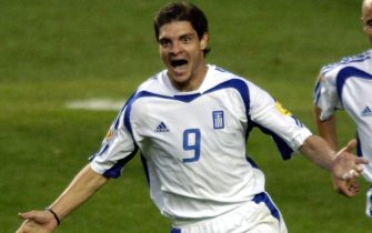 epa000226634 Greek striker Angelos Charisteas celebrates after scoring the 1-0 lead during the Euro 2004 final between Portugal and Greece at Luz stadium in Lisbon on Sunday, 04 July 2004.  EPA/OLIVER BERG NO MOBILE PHONE APPLICATIONS