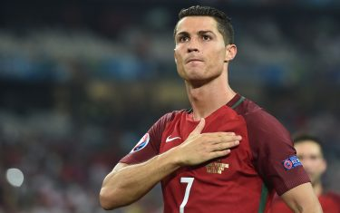 Portugal's forward Cristiano Ronaldo  celebrates after winning the Euro 2016 quarter-final football match between Poland and Portugal at the Stade Velodrome in Marseille on June 30, 2016. / AFP / BERTRAND LANGLOIS        (Photo credit should read BERTRAND LANGLOIS/AFP via Getty Images)