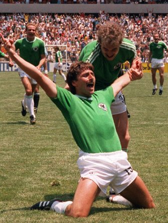 West German forward Klaus Allofs jubilates after scoring a goal against Uruguay as teammate Rudi Voller comes in to congratulate him, 04 June 1986 at Queretaro Estadio Corregidora, during the 1986 World Soccer Cup match between West Germany and Uruguay. (Photo credit should read STAFF/AFP via Getty Images)