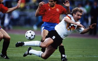 MUNICH, WEST GERMANY - JUNE 17:  Rudi Voller of West Germany is tackled by Manuel Sanchis and Tomas Renones of Spain during the UEFA European Championships 1988 Group 1 match between West Germany and Spain held on June 17, 1988 at the Olympiastadion in Munich, West Germany. (Photo by David Cannon/Allsport/Getty Images)