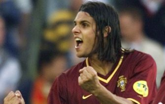 BRUSSELS, BELGIUM:  Portuguese forward Nuno Gomes jubilates after scoring the first goal of his team during the Euro-2000 semi-final match between Portugal and France at the King Baudouin stadium in Brussels, 28 June 2000.  AFP PHOTO - PATRICK HERTZOG (Photo credit should read PATRICK HERTZOG/AFP via Getty Images)