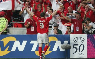LISBON, PORTUGAL - JUNE 21: Wayne Rooney of England celebrates his goal during the UEFA Euro 2004, Group B match between Croatia and England at the Luz Stadium on June 21, 2004 in Lisbon, Portugal. (Photo by Ross Kinnaird/Getty Images)