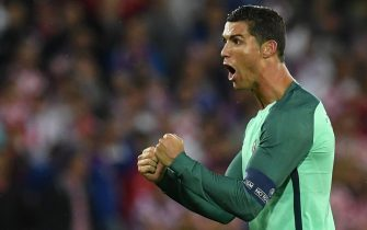 TOPSHOT - Portugal's forward Cristiano Ronaldo celebrates after winning the round of sixteen football match Croatia against Portugal of the Euro 2016 football tournament, on June 25, 2016 at the Bollaert-Delelis stadium in Lens. / AFP PHOTO / FRANCISCO LEONG        (Photo credit should read FRANCISCO LEONG/AFP via Getty Images)