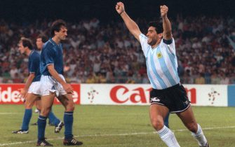 Argentinian forward Diego Maradona R) celebrates after teammate Claudio Caniggia (not pictured) tied the score at 1 during the World Cup semifinal soccer match between Italy and Argentina 03 July 1990 in Naples. Argentina and Italy played to a 1-1 tie but Argentina advanced to the final with a 4-3 victory on penalty kicks dashing the hopes of Italian fans of seeing a World Cup victory by their team on home soil.   AFP PHOTO/DANIEL GARCIA (Photo credit should read DANIEL GARCIA/AFP via Getty Images)