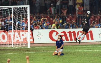 Argentinian goalkeeper Sergio Goycochea celebrates after stopping the penalty kick of Italian Roberto Donadoni (on ground) during the penalty shootout of the World Cup semifinal soccer match between Argentina and Italy 03 July 1990 in Naples. Argentina advanced to the final with a 4-3 victory on penalty kicks after the two teams were tied at 1 at the end of extra time. AFP PHOTO/PASCAL GEORGE (Photo credit should read PASCAL GEORGE/AFP via Getty Images)