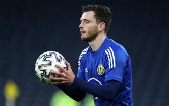 Scotland's Andrew Robertson warming up prior to kick-off during the 2022 FIFA World Cup Qualifying match at Hampden Park, Glasgow. Picture date: Wednesday March 31, 2021.