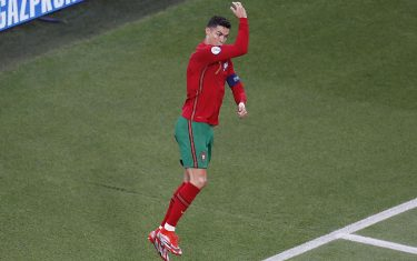 epa09297571 Cristiano Ronaldo of Portugal celebrates after scoring his team's first goal during the UEFA EURO 2020 group F preliminary round soccer match between Portugal and France in Budapest, Hungary, 23 June 2021.  EPA/Laszlo Balogh / POOL (RESTRICTIONS: For editorial news reporting purposes only. Images must appear as still images and must not emulate match action video footage. Photographs published in online publications shall have an interval of at least 20 seconds between the posting.)