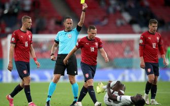 Czech Republic's Jan Boril (centre) receives a yellow card for a foul on England's Bukayo Saka during the UEFA Euro 2020 Group D match at Wembley Stadium, London. Picture date: Tuesday June 22, 2021.