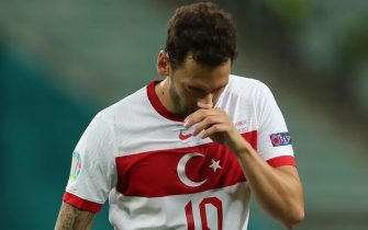 epa09288994 Hakan Calhanoglu of Turkey reacts during the UEFA EURO 2020 group A preliminary round soccer match between Switzerland and Turkey in Baku, Azerbaijan, 20 June 2021.  EPA/Tolga Bozoglu / POOL (RESTRICTIONS: For editorial news reporting purposes only. Images must appear as still images and must not emulate match action video footage. Photographs published in online publications shall have an interval of at least 20 seconds between the posting.)