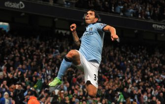 epa03666149 Carlos Tevez of Manchester City celebrates his goal against Wigan Athletic to make the game 1-0 during the English Premier League soccer match between Manchester City and Wigan Athletic at The Etihad Stadium in Manchester, Britain, 17 April 2013.  EPA/DAVID RICHARDS https://www.epa.eu/downloads/DataCo-TCs.pdf