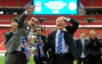 epa03696624 Wigan Athletic chairman Dave Whelan (R) celebrates with Wigan manager Roberto Martinez with the FA Cup following their teams 1-0 win over Manchester City during the F.A Cup final at Wembley Stadium in London, Britain, 11 May 2013.  EPA/ANDY RAIN DataCo terms and conditions apply. https://www.epa.eu/downloads/DataCo-TCs.pdf
