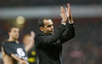 epa03721356 (FILE) A file picture dated 14 May 2013 shows Wigan Athletic manager Roberto Martinez applauding supporters after the English Premier League soccer match between Arsenal FC and Wigan Athletic in London, Britain. Spanish manager Roberto Martinez resigned on 28 May 2013 after leading Wigan Athletic to a historic FA Cup triumph over manchester City, according to British media reports.  EPA/KERIM OKTEN DataCo terms and conditions apply. https://www.epa.eu/downloads/DataCo-TCs.pdf