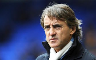 epa03697469 (FILE) A file photograph dated 16 March 2013 shows Manchester City manager Roberto Mancini reacting during the English Premier League soccer match at Goodison, Liverpool, Britain. British media reports on 12 May 2013 state that Roberto Mancini is set to be sacked as manager of Manchester City.  EPA/PETER POWELL DataCo terms and conditions apply.  https://www.epa.eu/downloads/DataCo-TCs.pdf