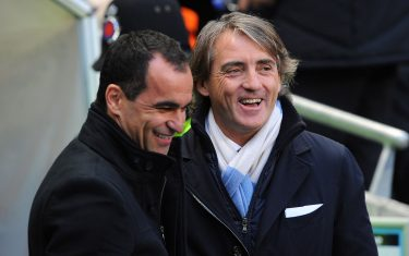 Wigan Athletic manager Roberto Martinez (left) with Manchester City manager Roberto Mancini (right) before kick-off   (Photo by Martin Rickett/PA Images via Getty Images)