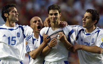 epa000226627 Greek striker Angelos Charisteas (2nd right) celebrates with team-mates (from left) Zisis Vryzas, Stylianos Giannakopoulos and Konstantinos Katsouranis after scoring the 1-0 lead during the Euro 2004 final between Portugal and Greece at Luz stadium in Lisbon on Sunday, 04 July 2004.  EPA/MATTHIAS SCFHRADER NO MOBILE PHONE APPLICATIONS
