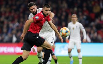 epa08004774 Albania's Berat Djimsiti (front) in action against France's Olivier Giroud (back) during the UEFA EURO 2020 qualifying soccer match between Albania and France in Tirana, Albania, 17 November 2019.  EPA/MALTON DIBRA