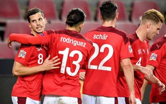 epa08741721 Switzerland's Remo Freuler (L) celebrates with his teammates after scoring the 2-0 lead during the UEFA Nations League group stage, league A, group 4 soccer match  between Germany and Switzerland in Cologne, Germany, 13 October 2020.  EPA/SASCHA STEINBACH