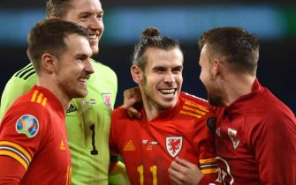epa08010045 (from left) Aaron Ramsey, goalkeeper Wayne Hennessey, Gareth Bale and Chris Gunter of Wales celebrate after the UEFA EURO 2020 Group E qualification match between Wales and Hungary in Cardiff, Wales, Britain, 19 November 2019. Wales won 2-0.  EPA/PETER POWELL