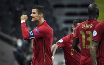 epa08655246 Portugal's Cristiano Ronaldo celebrates after scoring a goal against Sweden, his 100th for the Portuguese national team, during the UEFA Nations League, division A, group 3 soccer game betwween Sweden and Portugal at Friends Arena in Stockholm, Sweden, 08 September 2020.  EPA/Janerik Henriksson/TT SWEDEN OUT