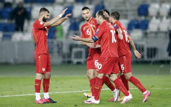 epa08816279 North Macedonia's Gorand Pandev (2-R) celebrates with teammates after scoring his team's first goal during the UEFA Euro qualifying playoff finals soccer match between Georgia and North Macedonia at the Boris Paichadze Dinamo Arena national stadium in Tbilisi, Georgia, 12 November 2020.  EPA/ZURAB KURTSIKIDZE