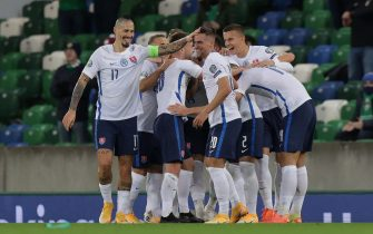 epa08816507 Slovakia's players celebrate after Juraj Kucka scores the 0-1 goal during the UEFA EURO 2020 play-off soccer match between Northern Ireland and Slovakia at Windsor Park stadium in Belfast Northern Ireland, 12 November 2020.  EPA/JOHN MCVITTY