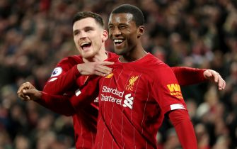 Liverpool's Georginio Wijnaldum (right) celebrates scoring his side's fifth goal of the game with team-mate Andrew Robertson during the Premier League match at Anfield, Liverpool.
