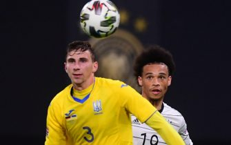 epa08820791 Germany's Leroy Sane (R) in action against Ukraine's Illia Zabarnyi (L) during the UEFA Nations League soccer match between Germany and Ukraine in Leipzig, Germany, 14 November 2020.  EPA/CLEMENS BILAN