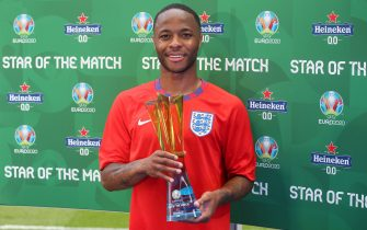 """LONDON, ENGLAND - JUNE 13: Raheem Sterling of England poses for a photograph with their Heineken """"Star of the Match"""" award after the UEFA Euro 2020 Championship Group D match between England and Croatia at Wembley Stadium on June 13, 2021 in London, England. (Photo by Alex Morton - UEFA/UEFA via Getty Images)"""