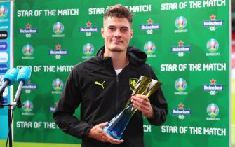 """GLASGOW, SCOTLAND - JUNE 14: Patrik Schick of Czech Republic poses for a photograph with their Heineken """"Star of the Match"""" award after the UEFA Euro 2020 Championship Group D match between Scotland v Czech Republic at Hampden Park on June 14, 2021 in Glasgow, Scotland. (Photo by Jan Kruger - UEFA/UEFA via Getty Images)"""