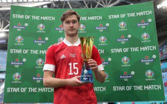 """SAINT PETERSBURG, RUSSIA - JUNE 16: Aleksei Miranchuk of Russia poses for a photograph with their Heineken """"Star of the Match"""" award after the UEFA Euro 2020 Championship Group B match between Finland and Russia at Saint Petersburg Stadium on June 16, 2021 in Saint Petersburg, Russia. (Photo by Gonzalo Arroyo - UEFA/UEFA via Getty Images)"""
