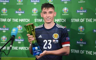"""LONDON, ENGLAND - JUNE 18: Billy Gilmour of Scotland poses for a photograph with their Heineken """"Star of the Match"""" award after the UEFA Euro 2020 Championship Group D match between England and Scotland at Wembley Stadium on June 18, 2021 in London, England. (Photo by Shaun Botterill - UEFA/UEFA via Getty Images)"""