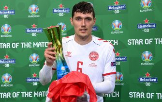 """COPENHAGEN, DENMARK - JUNE 21: Andreas Christensen of Denmark poses for a photograph with the Heineken """"Star of the Match"""" award after the UEFA Euro 2020 Championship Group B match between Russia and Denmark at Parken Stadium on June 21, 2021 in Copenhagen, Denmark. (Photo by Oliver Hardt - UEFA/UEFA via Getty Images)"""