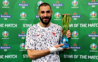 """BUDAPEST, HUNGARY - JUNE 23: Karim Benzema of France poses for a photograph with the Heineken """"Star of the Match"""" award after the UEFA Euro 2020 Championship Group F match between Portugal and France at Puskas Arena on June 23, 2021 in Budapest, Hungary. (Photo by Alex Livesey - UEFA/UEFA via Getty Images)"""