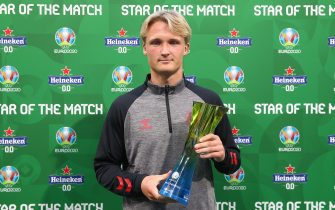 """AMSTERDAM, NETHERLANDS - JUNE 26: Kasper Dolberg of Denmark poses for a photograph with the Heineken """"Star of the Match"""" award after the UEFA Euro 2020 Championship Round of 16 match between Wales and Denmark at Johan Cruijff Arena on June 26, 2021 in Amsterdam, Netherlands. (Photo by Christopher Lee - UEFA/UEFA via Getty Images)"""