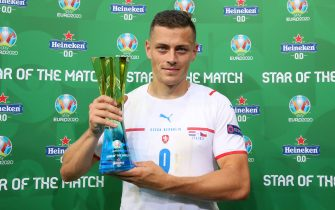 """BUDAPEST, HUNGARY - JUNE 27: Tomas Holes of Czech Republic poses for a photograph with their Heineken """"Star of the Match"""" award after the UEFA Euro 2020 Championship Round of 16 match between Netherlands and Czech Republic at Puskas Arena on June 27, 2021 in Budapest, Hungary. (Photo by Alex Livesey - UEFA/UEFA via Getty Images)"""