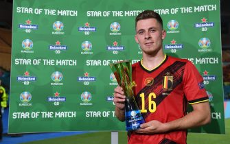 """SEVILLE, SPAIN - JUNE 27: Thorgan Hazard of Belgium poses for a photograph with their Heineken """"Star of the Match"""" award after the UEFA Euro 2020 Championship Round of 16 match between Belgium and Portugal at Estadio La Cartuja on June 27, 2021 in Seville, Spain. (Photo by Aitor Alcalde - UEFA/UEFA via Getty Images)"""