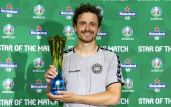 """BAKU, AZERBAIJAN - JULY 03: Thomas Delaney of Denmark poses for a photograph with their Heineken """"Star of the Match"""" award after the UEFA Euro 2020 Championship Quarter-final match between Czech Republic and Denmark at Baku Olimpiya Stadionu on July 03, 2021 in Baku, Azerbaijan. (Photo by Matthew Lewis - UEFA/UEFA via Getty Images)"""