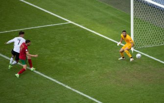 19 June 2021, Bavaria, Munich: Football: European Championship, Portugal - Germany, preliminary round, Group F, 2nd matchday in the EM Arena. Portugal's Ruben Dias scores the 1:1 for the German team with an own goal. Photo: Federico Gambarini/dpa - IMPORTANT NOTE: In accordance with the regulations of the DFL Deutsche Fußball Liga and/or the DFB Deutscher Fußball-Bund, it is prohibited to use or have used photographs taken in the stadium and/or of the match in the form of sequence pictures and/or video-like photo series.