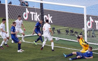 epa09296212 Juraj Kucka of Slovakia (C) scores an oqn goal making the score 5-0 for Spain during the UEFA EURO 2020 group E preliminary round soccer match between Slovakia and Spain in Seville, Spain, 23 June 2021.  EPA/Julio Munoz / POOL (RESTRICTIONS: For editorial news reporting purposes only. Images must appear as still images and must not emulate match action video footage. Photographs published in online publications shall have an interval of at least 20 seconds between the posting.)