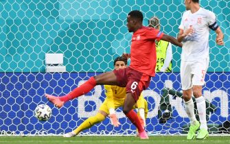 Switzerland's midfielder Denis Zakaria (L) tries to deflect the ball before his team conceded a goal to Spain during the UEFA EURO 2020 quarter-final football match between Switzerland and Spain at the Saint Petersburg Stadium in Saint Petersburg on July 2, 2021. (Photo by Kirill KUDRYAVTSEV / POOL / AFP) (Photo by KIRILL KUDRYAVTSEV/POOL/AFP via Getty Images)
