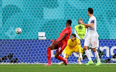 SAINT PETERSBURG, RUSSIA - JULY 02: The ball deflects off Denis Zakaria of Switzerland past Yann Sommer leading to the Spain first goal scored by Jordi Alba (Not pictured) during the UEFA Euro 2020 Championship Quarter-final match between Switzerland and Spain at Saint Petersburg Stadium on July 02, 2021 in Saint Petersburg, Russia. (Photo by Kirill Kudryavstev - Pool/Getty Images)