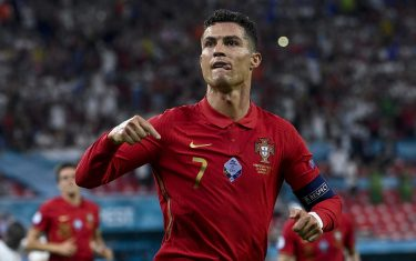 epa09297310 Cristiano Ronaldo of Portugal celebrates aftter he scored a goal during the Portugal vs. France match in the third round of Group F of the Euro 2020 soccer tournament in Puskas Ferenc Arena in Budapest, Hungary, 23 June 2021.  EPA/Zsolt Szigetvary HUNGARY OUT